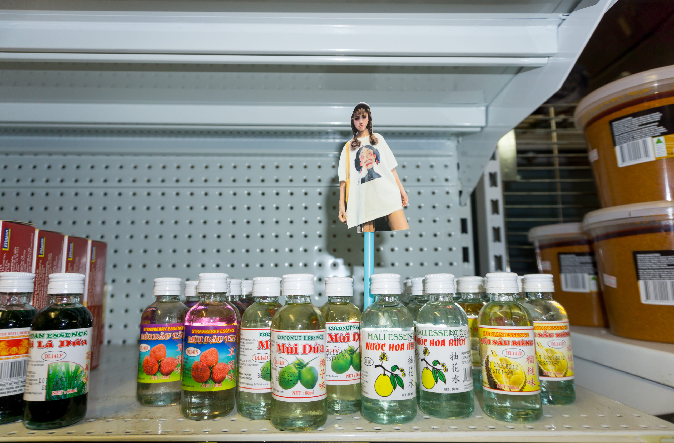 Ava Phen and Glenn Young, CHUTZPAH, 2020. photograph of Honey Girl Taobao model Soo OK, plastic straw, flavouring oils